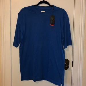 NWT Greg Norman blue shirt size Med.